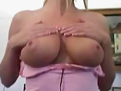 Lisa strips and fingering her pussy