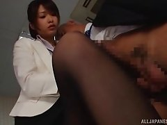 Secretary gives her boss a nylon footjob that drives him wild