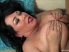 Chubby dark-haired cougar with a shaved pussy sucking a stranger's cock