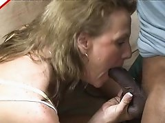 Cute mature blonde gives great head to a black dick
