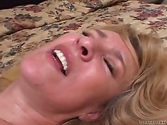 Raunchy looking MILF in sexy stockings likes dirty and raunchy sex