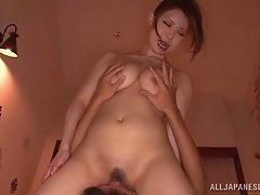 Asian slut oiled up and rocks dick in her tight cunt
