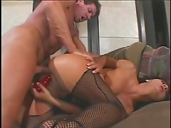 Sexy brunette Sandra Romain in fishnet lingerie face fucked by big cock