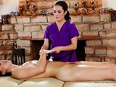 Seductive dark haired GF pleasures lusty mommy with steamy cunnilingus in massage parlor