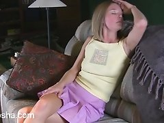 Horny teen masturbates with a toy on the couch