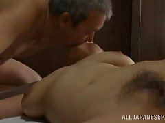 This guy gets on top of his Japanese wife and fucks her until she cums