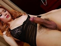 Asian tranny Lisa T shows her hairy asshole and hard cock