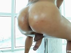 Oiled up shemale slut Jamie Croft stroking her cock