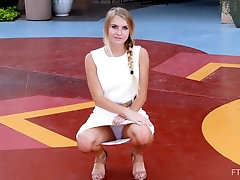 Amateur blonde teen Angelina exposes her panties in public