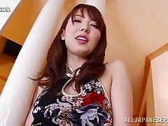 Asian redhead jamming her furry furnace with a dildo close up