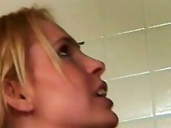 Young blonde girl sucking a really big black dick