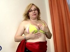 Buxom mature blonde BBW MILF Rebeca strips and pounds her pussy solo