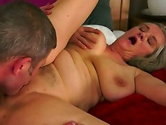 Chubby and bosomy granny gives nice head to a freak