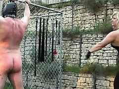 Femdom harshly punish sub with whips outdoor