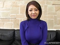 Sensuous Asian wife giving a blazing tit job after getting her hairy beaver fingered