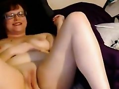 Mature Woman Masturbates With A Wand
