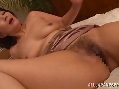 Flirtatious Asian lesbian milf mans while getting her pussy licked in the bedroom