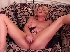 Fingers and a vibrating pink toy arouse her mature pussy