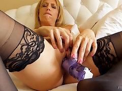 Masturbating blonde MILF Stevie reaches intense screaming orgasm