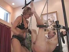 Femdom domina mistress pegs her BDSM slave with a strapon