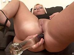 Naughty girl Kika slurps on a black dick after she masturbated with big dildo