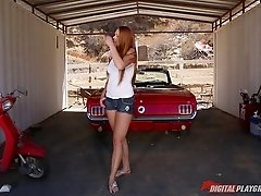 Gorgeous redhead turned on by his convertible takes his dick