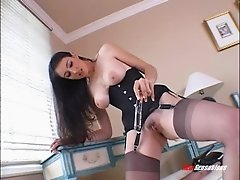 Solo busty slut wearing a corset and dildoing herself vigorously