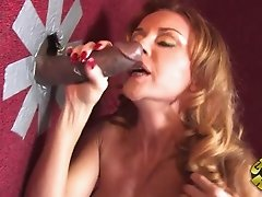Milf with Big Tits Sucks Big Black Cock in a Gloryhole