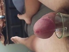 Precum into a shot glass hands free