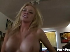 Blonde with huge tits wants us to take a look at her beaver!