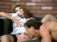 Curly-haired whore gives her man a nice blowjob in 69 position