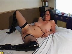 Mature brunette in stockings ravished hardcore in interracial porn