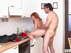 German milf rewards her repair man with a hot fuck in the kitchen