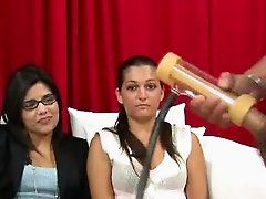 Women watch men using hand job toy