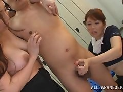 Nerdy guy jerked off by two sluts in locker room in FFM Asian porn