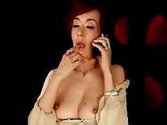 Mature Japanese babe hooks up in a variety of video clips