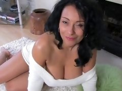 Voluptuous brunette with a beautiful smile, Danica Collins is about to get naked for us