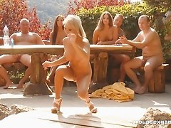 Naked friends have a blast while participating in an outdoor orgy