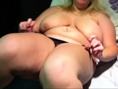 Chunky blonde sets her big hooters free and rubs her peach