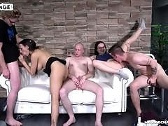 Long haired Mea Melone surrounded by cocks to fuck and suck