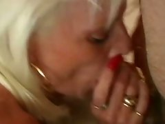 Busty mature blondie with long red nails had steamy oral gangbang in the office