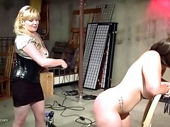 Chubby blonde mistress gives her brunette slave a rough pussy pounding