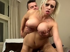 Sindy enjoys fucking with a young guy in different poses until he cums