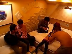 Three guys gangbang a sexy Japanese girl and shower her with jizz