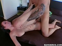 Brunette porn star with big tits is fucked hard in doggy style