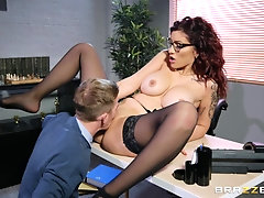 Redhead secretary in a miniskirt blows her boss at the office