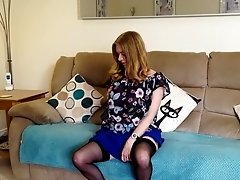 Mature brunette amateur MILF Lily May strips and fingers herself