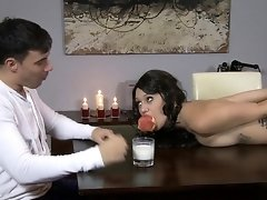 Slutty brunette slave can remove her ball gag only to suck cock