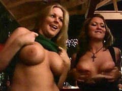 Amateur girls kissing at the bar and flashing their tits
