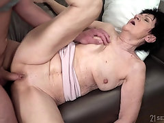 short hair mature Anastasia likes to ride on a friend's dick on the bed